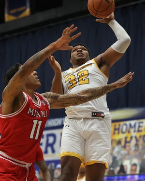 Kent State junior forward Gabe O'Neal scores during the second half of Tuesday night's battle with Miami at the M.A.C. Center.