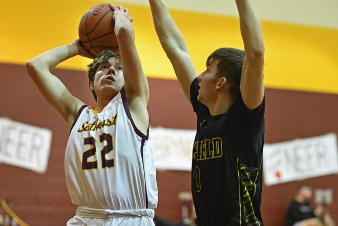 Southeast's Caden Bailey puts up a shot over Garfield's Owen Janic during the first half of their game, Tuesday at Southeast High School.