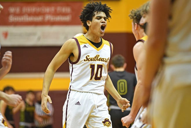 Southeast's Brandon Clint celebrates after hitting a shot and forcing a Garfield timeout during the first half of their game, Tuesday at Southeast High School.