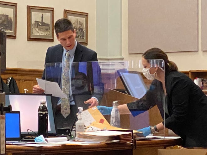 Micah Ault and Stephanie Anderson, attorneys with the Ohio Attorney General's Office, review evidence being submitted in the trial of Classie Hawthorne in Stark County Common Pleas Court. The attorneys are serving as special prosecutors. Hawthorne is charged with voluntary manslaughter in the 2018 shooting death of her husband, Cleveland Hawthorne.