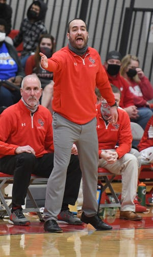 Canton South head coach Luke Conley coaches his team during a home game against West Branch on Feb. 2, 2021 — his 34th birthday. Later in the week his wife gave birth to the couple's first child, a daughter.
