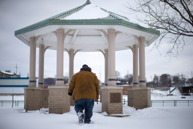 A man walks to the gazebo at Davis Park on Tuesday, Feb. 2, 2021, in Rockford. The city is bracing for the coldest days of the year over the upcoming weekend.