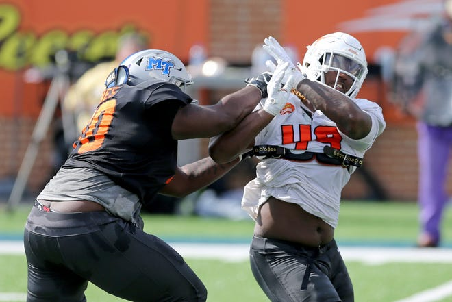 National Team offensive lineman Robert Jones of Middle Tennessee State (70) blocks defensive lineman Ta'Quon Graham of Texas (49) during practice for the Senior Bowl on Jan. 27 in Mobile, Ala. Jones, a former East High School lineman, is hoping to play in the NFL.