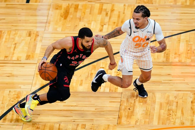 Toronto Raptors guard Fred VanVleet, left, drives around Orlando Magic guard Cole Anthony (50) during the first half of an NBA basketball game, Tuesday, Feb. 2, 2021, in Orlando, Fla.