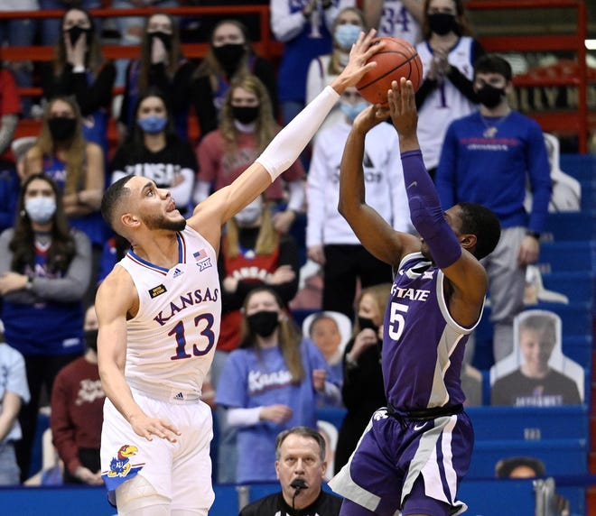 Kansas forward Tristan Enaruna blocks a shot attempt by Kansas State's Rudi Williams on Tuesday night at Allen Fieldhouse.