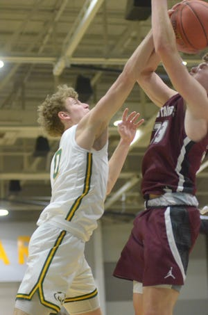 Salina South's Colin Schreiber (0) blocks a shot by Salina Central's Nolan Puckett (33) during their game on Feb. 2 at the South gym. The crosstown rivals will meet in the Class 5A sub-state semifinals at 7 p.m. Wednesday at the South gym.