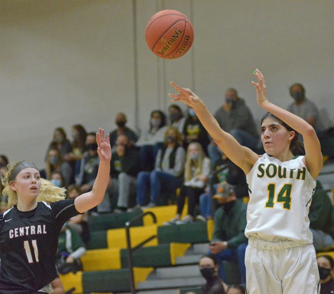 Salina South forward Lizzy Franco (14) puts up a shot over Salina Central's Landry Stewart (11) during Tuesday's game at the South gym.