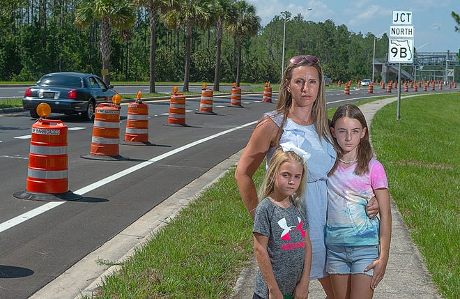 Heather Henry stands with her daughters, Addisyn, then 8, and Ryleigh, then 9, in this file photo from 2018, shortly after a sidewalk was installed next to State Road 9B. Henry and other parents were concerned about student safety walking the path to school and the issue has been raised once again.