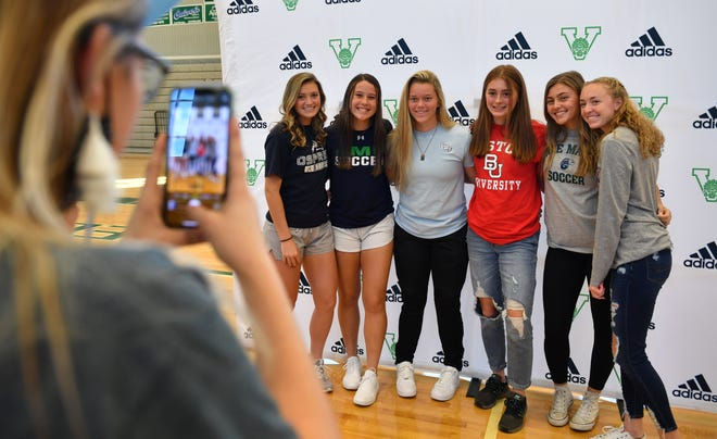 Members of the Venice High girls soccer team pose for a photo together before their signing ceremony Wednesday afternoon in the Venice High gym.  Sixteen Venice High student-athletes signed letters of commitment to play sports for colleges or universities. From left: Kiersten Slattery, University of North Florida; Rachel Dalton, Ave Maria University; Ashton Pennell, University of West Florida; Eileen Solomon, Boston University; Madelyn Krause, Ave Maria University; Addison Chamberlain, Converse College.