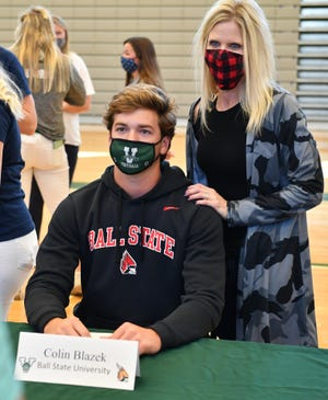 Sixteen Venice High student-athletes signed letters of commitment during a signing ceremony Wednesday afternoon in the school gym.  Quarterback Colin Blazek is headed to Ball State University.