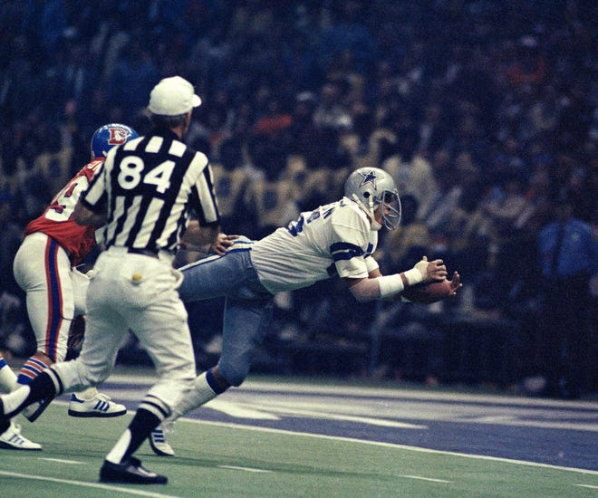 Dallas Cowboys' Butch Johnson catches the game-winning pass in the end zone that gave the Cowboys a 27-10 victory over the Denver Broncos in Super Bowl XII, Jan. 15, 1978, at the Louisiana Superdome in New Orleans. [The Associated Press/File]