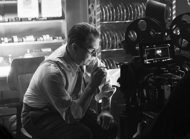 """In this image released by Netflix, Gary Oldman portrays Herman Mankiewicz in a scene from """"Mank."""" On Wednesday the film was nominated for a Golden Globe for best motion picture drama."""