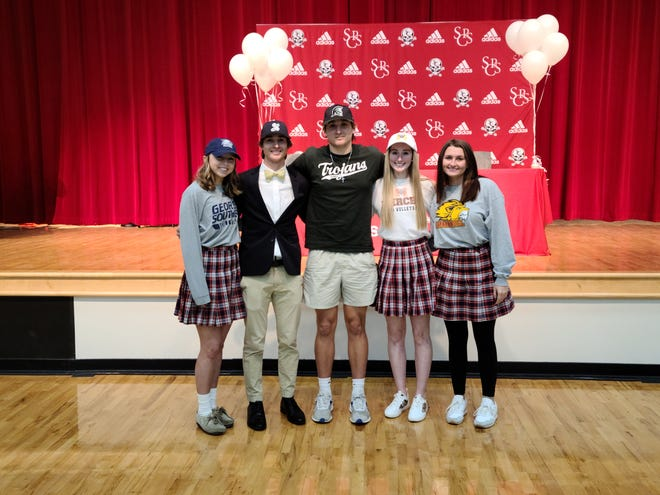 From left, Logan Jones, Joey White, Cooper George, Lexi Polychrones and Abby Chambers each signed national letters of intent on Wednesday at Savannah Christian.