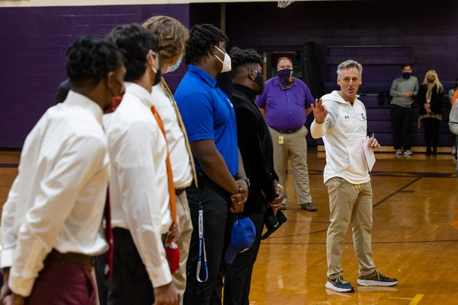 Head football coach Mark Stroud talks about the six players who signed ceremonial letters of intent Wednesday during a National Signing Day ceremony at Calvary Day School.