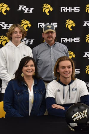 Richmond Hill senior kicker Britton Williams, bottom right, with parents Darin and Jenny Williams and his younger brother during the signing ceremony Wednesday at Richmond Hill High School.