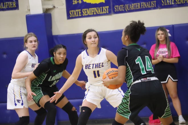 Bethel's Hannah Davidson (11) guards Jones' Audrey Bain and Bethel's Adyson Adamek (left) defends in the background Tuesday night at B.E. Cantrell Fieldhouse.
