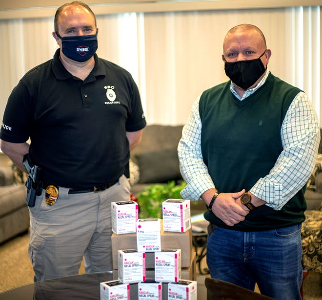SSC Police Chief Shane Marshall (left) thanks Gateway to Prevention and Recovery Coordinator David Holland (right) for the donation of 10 NARCAN kits to Seminole State College on Feb. 2.  PROVIDED/SSC