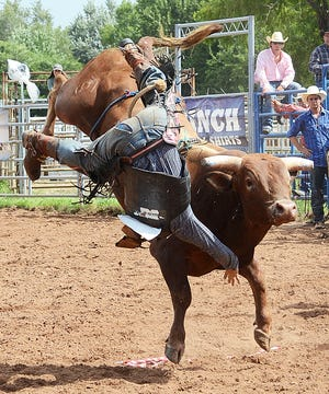 A bullrider is pictured during a previous IFYR in Shawnee. After being canceled in 2020 because of the pandemic, the 2021 rodeo is scheduled July 11-16.