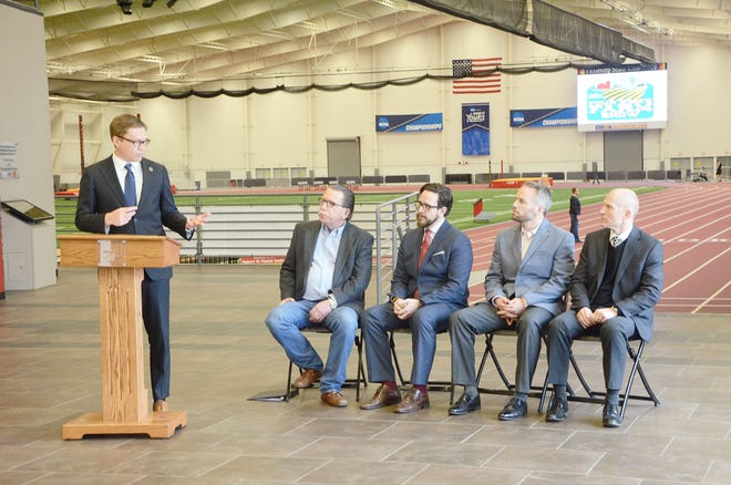 Kansas Secretary of Commerce David Toland, left, speaks at a February 2020 event announcing the Four State Farm Show's move to Pittsburg State University.