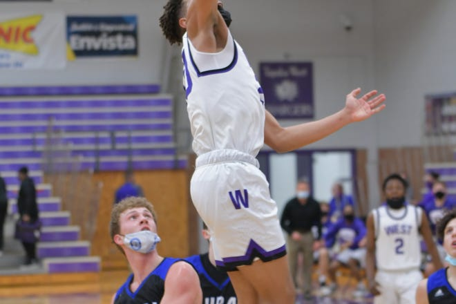 Topeka West's Trevion Alexander throws down a dunk during the Chargers' 63-46 win over Washburn Rural on Tuesday night at West.