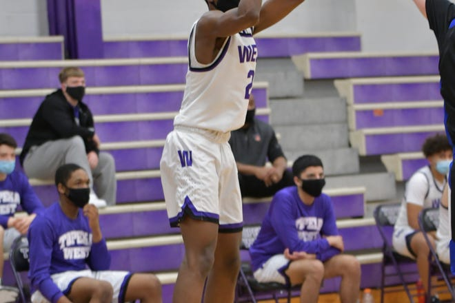 Topeka West senior guard Marque Wilkerson set the tone for the Chargers' 63-46 win over Washburn Rural in a showdown of the Centennial League leaders. Wilkerson scored a game-high 25 points.