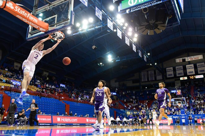 Kansas sophomore guard Christian Braun dunks during a fast break in the first half of Tuesday night's matchup with Kansas State at Allen Fieldhouse in Lawrence. Braun scored a team high-tying 18 points as the No. 23-ranked Jayhawks won the Sunflower Showdown matchup 74-51.
