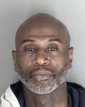 Raynard Walton, 54, was being held Wednesday in the Shawnee County Jail in connection with burglaries of southwest Topeka accounting and chiropractic businesses.