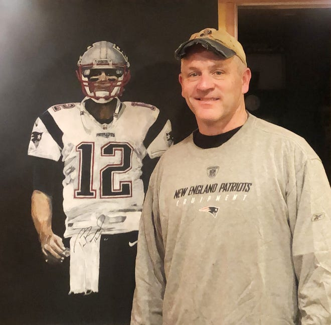 "Tom Hurley of Worcester with his painting of Tom Brady that he calls ""TB 12 G.O.A.T. (Greatest Of All Time)"""