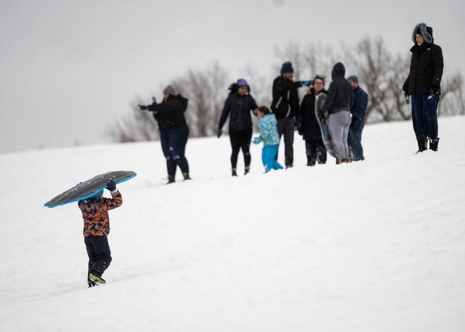 WORCESTER - A kid carries his sled up the hill at Green Hill Park on Tuesday, February 2, 2021.