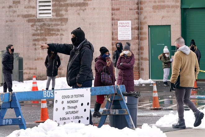 People on line are directed at a COVID-19 testing site, Wednesday in Roxbury.