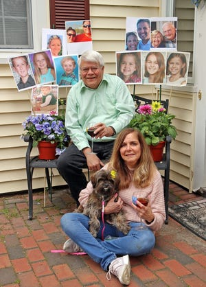 Dr. Bob Fraser and his wife, Beth, with photos of his parents and their children and grandchildren, whom they have not seen much in person since COVID began.
