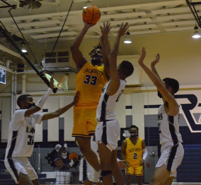 An inside-out center for Jack Britt, Demetri Patterson (33) hit the go-ahead jumper in the Bucs' 65-60 overtime win at Purnell Swett on Tuesday.