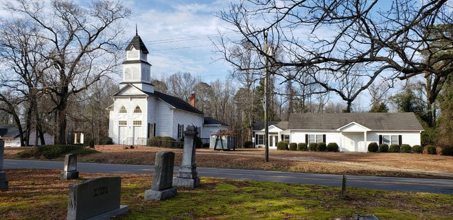 ThorsHof: Second Hof of the Asatru Folk Assembly, is located in the former building for Parker's Grove United Methodist Church in Linden, North Carolina. The Asatru Folk Assembly has been designated a hate group by the Southern Poverty Law Center, which tracks extremist groups. In the foreground is the Parker's Grove church cemetery, which was not sold to the pagan group.