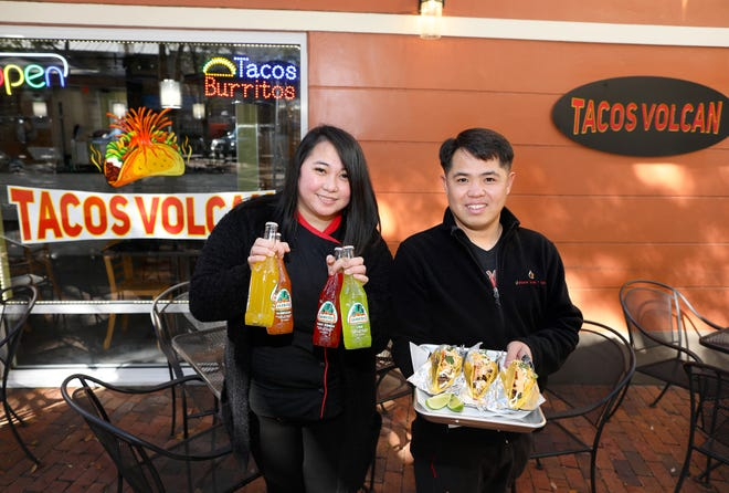 Louella Suataron, left, general manager, and Nestor Espartero, who owns Volcanic Sushi + Sake, outside their new restaurant called Tacos Volcan, on Wednesday in the Haile Village.