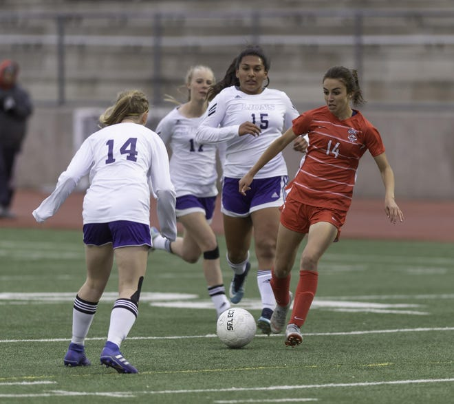 Centennial High School's Allie Jones, right, looks to pass the ball against Littleton in the first round of the Class 4A playoffs May 8, 2019 at Dutch Clark Stadium.