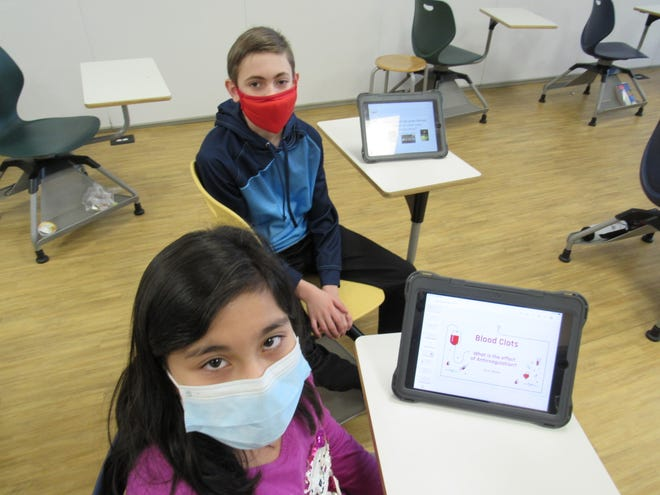 Tanvi Maloo (front) and Nicholas Thompson, two fifth-graders at New Albany Intermediate School, will compete in this year's New Albany-Plain Local science fair, which begins this month. Students whose work receives a superior rating can advance to a regional contest.