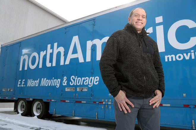 Brian Brooks, E.E. Ward Moving & Storage Co. co-owner, stands near one of his company's semitrucks Feb. 2 in Grove City. The company, at 2235 Southwest Blvd., is marking its 140th anniversary and is the oldest known Black-owned business in the United States.