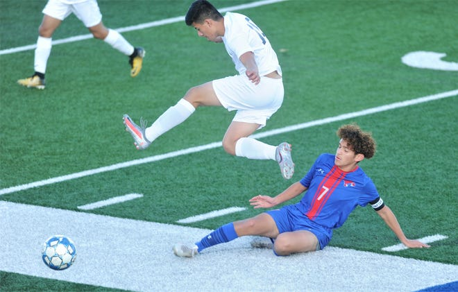 Snyder's Edgar Gomez leaps over Cooper's Ramiro Padilla after Padilla knocks the ball away from Gomez in the first half.