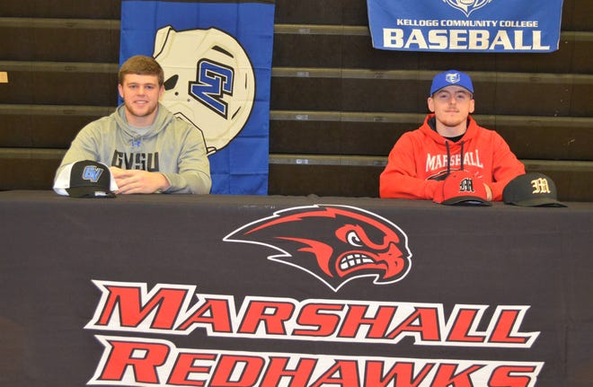 Marshall standout Trenton Fuller, left, and Cooper Middleton at a ceremony at Marshall High School on National Signing Day. Fuller has committed to play football at Grand Valley State University and Middleton will play at baseball at Kellogg Community College.