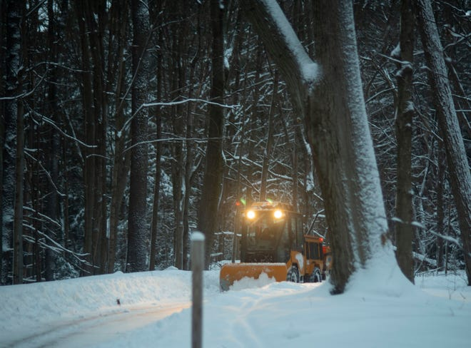 A plow makes its way down the South Burlington Recreation Path early Wednesday, Feb. 3, 2021.  A storm that began Monday night brought as much as 10 inches of snow to the area.