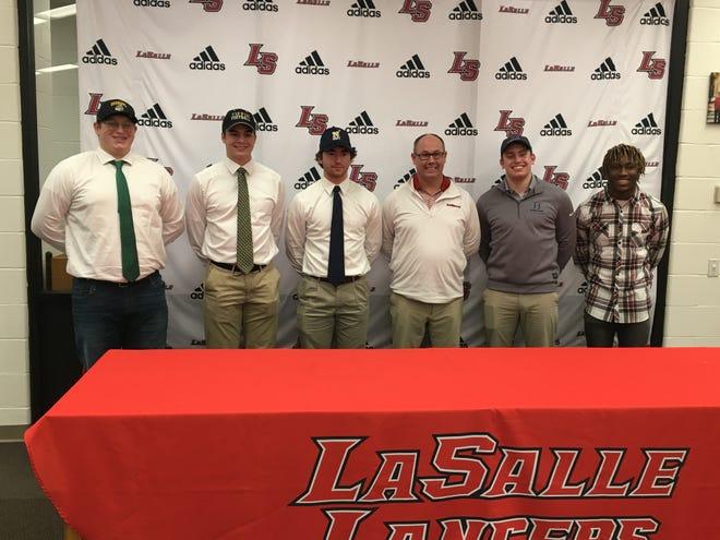 La Salle Lancers signed letters to play collegiate football. Pictured: Gavin Robbins, Cole Schneider (Tiffin), Zach Branam, (Navy) Will Heffner (Hillsdale) and DeAgo Brumfield (Campbellsvile).