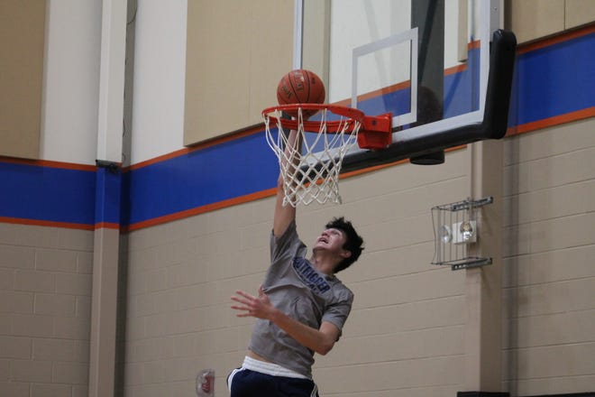 7-footer Sage Tolentino dunks at Ignition Training in Mason Feb. 3.