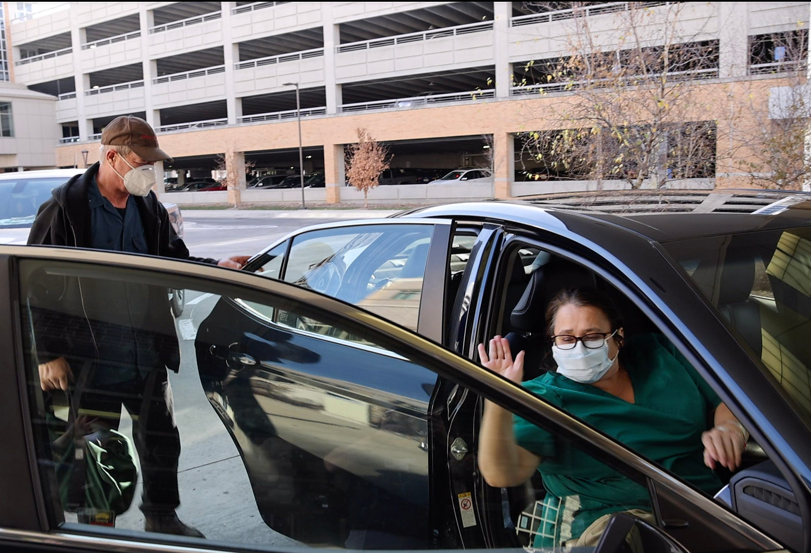 Mary Embrey waves goodbye as her husband, Ricky, picks her up from Mary Greeley Medical Center on Dec. 10 after treatment for COVID-19.