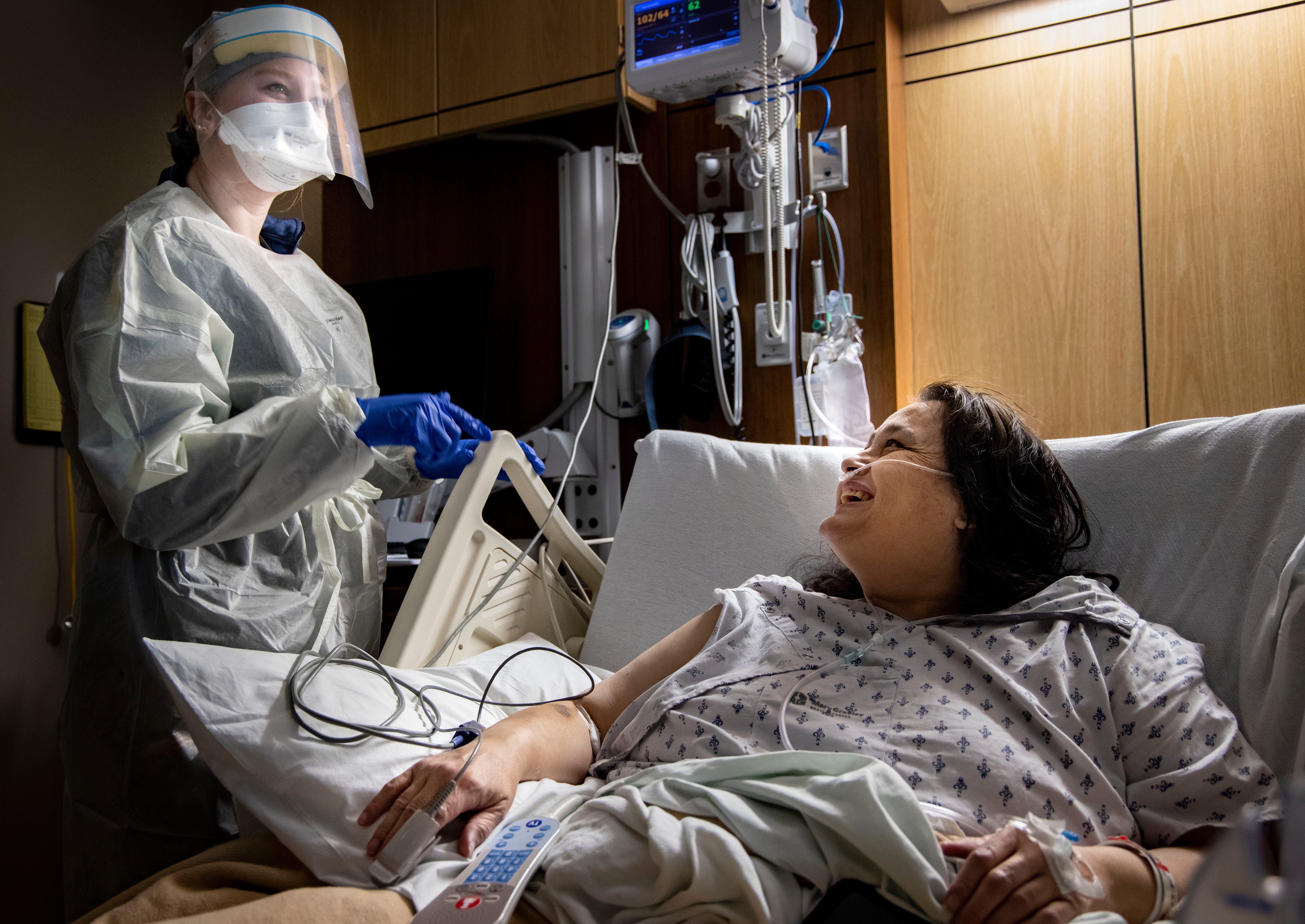 Nurse Connor Ramirez cares for Mary Embrey on Dec. 9 as she recovers from COVID-19 at Mary Greeley Medical Center in Ames.