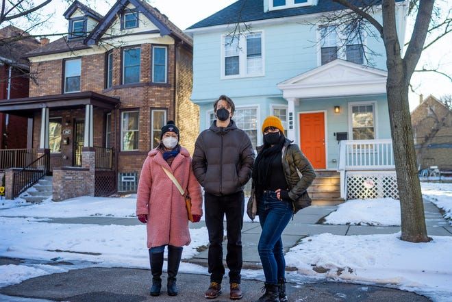 From left,  Laura Misumi, Geoffrey Leonard, and Jo Messer stand in front of Misumi and Leonard's former apartment on Feb. 3, 2021, in Detroit. The trio are plaintiffs and part of a tenants union, who have filed a lawsuit against two white developers alleging they discriminated against Black tenants.