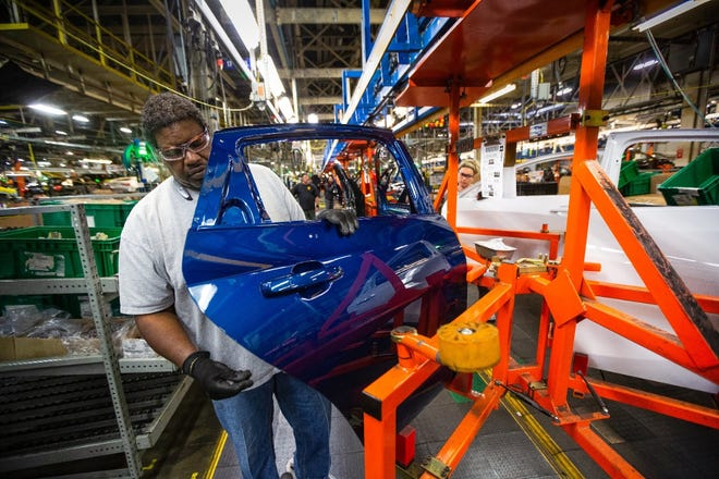 General Motors employees work on the assembly line Friday, April 26, 2019 at Fairfax Assembly & Stamping Plant in Kansas City, Kansas. The Fairfax facility produces the Cadillac XT4 and Chevrolet Malibu.