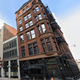 1500 Woodward Ave. in Detroit. The site will soon be home to Greyson Clothiers, a high -performance golf and activewear boutique.