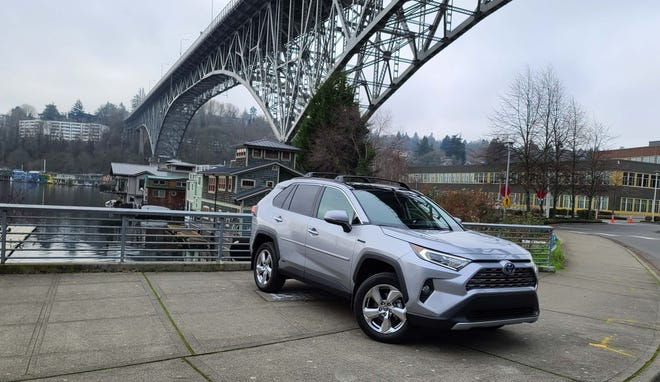 The 2021 Toyota RAV4 Hybrid delivers utility, 40 mpg, and no range anxiety common to electric SUVs.
