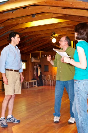 """Greg Vinkler, center, works with actor Sean Fortunato and choreographer Linda Fortunato during rehearsal for Peninsula Players Theatre's 2012 production of """"Chicago."""" Vinkler will retire at the end of the 2021 season after 28 years as Players' artistic director, with Linda Fortunato succeeding him."""