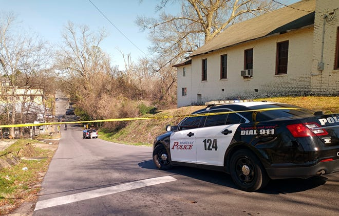 Police officers work the scene where authorities say police fatally shot a burglary suspect who was armed with a knife, Tuesday, Feb. 2, 2021, in Meridian, Miss.